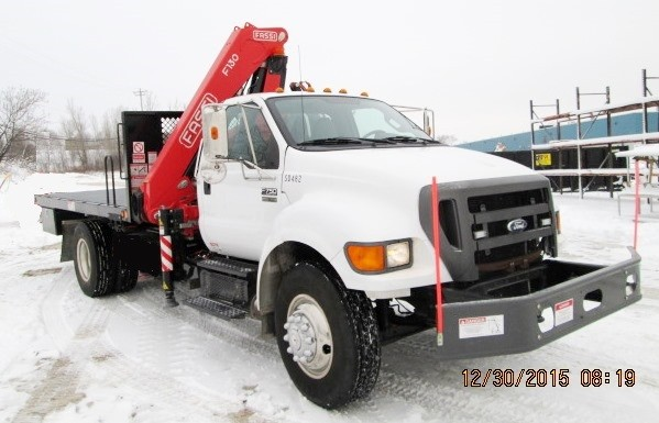Fassi F130A.23 knuckleboom on 2011 Ford F750 - Front passenger side