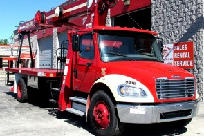 Terex BT3870 on 2012 Freightliner M2 106 Front curb side view cropped